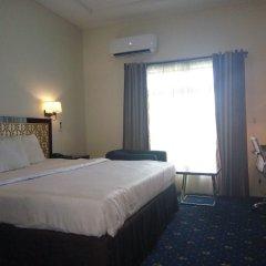 Отель Adig Suites Нигерия, Энугу - отзывы, цены и фото номеров - забронировать отель Adig Suites онлайн комната для гостей фото 4
