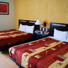 Отель Howard Johnson Plaza Las Torres Гвадалахара удобства в номере фото 2