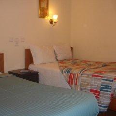 Отель Pensao Estacao Central Лиссабон комната для гостей фото 2