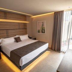 Отель Heat Suites - Adults Only комната для гостей фото 2