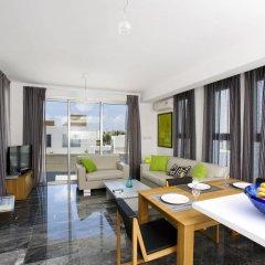 Отель Paradise Cove Luxurious Beach Villas Кипр, Пафос - отзывы, цены и фото номеров - забронировать отель Paradise Cove Luxurious Beach Villas онлайн комната для гостей фото 5