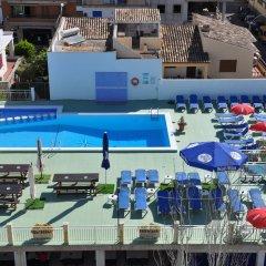 Отель Hostal Gami бассейн