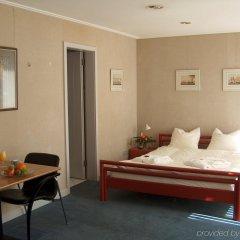 Отель Emma House, All Suite Цюрих комната для гостей
