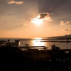 Отель Seaside Hotel Yakushima Япония, Якусима - отзывы, цены и фото номеров - забронировать отель Seaside Hotel Yakushima онлайн приотельная территория