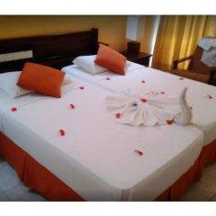 Отель Induruwa Beach Resort Шри-Ланка, Бентота - отзывы, цены и фото номеров - забронировать отель Induruwa Beach Resort онлайн сейф в номере