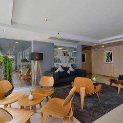 Отель The Grass Serviced Suites by At Mind гостиничный бар