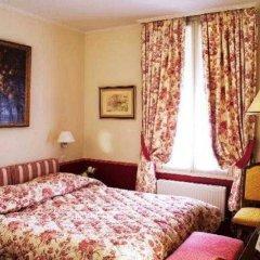 Отель Hôtel Exelmans сейф в номере