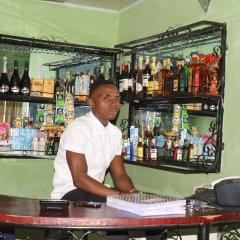 Отель Bv.Standard Executive Suite Нигерия, Калабар - отзывы, цены и фото номеров - забронировать отель Bv.Standard Executive Suite онлайн гостиничный бар