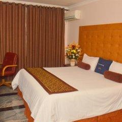 Отель Golden Tulip Port Harcourt Нигерия, Порт-Харкорт - отзывы, цены и фото номеров - забронировать отель Golden Tulip Port Harcourt онлайн комната для гостей фото 5