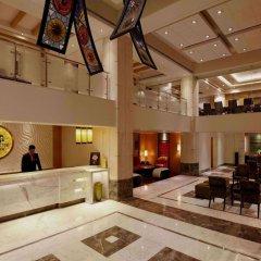 Отель Lemon Tree Premier Jaipur интерьер отеля