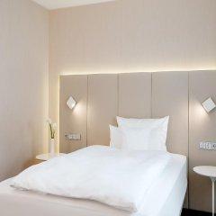 Отель NH Collection Frankfurt City 4* Стандартный номер с различными типами кроватей фото 6