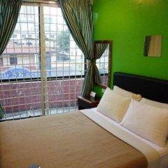 Отель Green Hut Lodge Малайзия, Куала-Лумпур - отзывы, цены и фото номеров - забронировать отель Green Hut Lodge онлайн комната для гостей