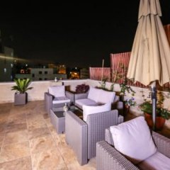 Отель Khuttar Apartments Иордания, Амман - отзывы, цены и фото номеров - забронировать отель Khuttar Apartments онлайн помещение для мероприятий фото 2