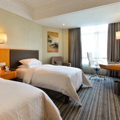Отель Ramada Plaza Shanghai Pudong Airport Китай, Шанхай - отзывы, цены и фото номеров - забронировать отель Ramada Plaza Shanghai Pudong Airport онлайн комната для гостей