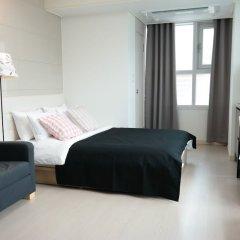 Апартаменты Myeongdong Studio комната для гостей