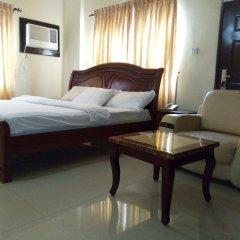 Апартаменты The Habitat Suites & Apartments Annex комната для гостей