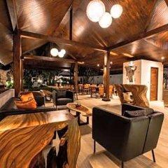 Отель Phuket Airport Guesthouse Таиланд, пляж Май Кхао - отзывы, цены и фото номеров - забронировать отель Phuket Airport Guesthouse онлайн гостиничный бар