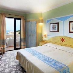 Отель Grand Hotel Smeraldo Beach Италия, Байя-Сардиния - 1 отзыв об отеле, цены и фото номеров - забронировать отель Grand Hotel Smeraldo Beach онлайн комната для гостей