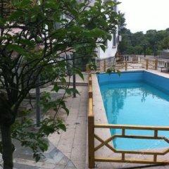 Xinyaqi Hotel бассейн