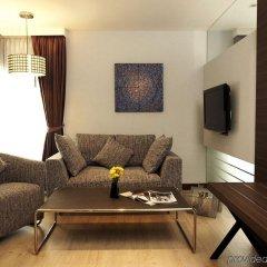 Отель Sukhumvit Suites Бангкок комната для гостей фото 5