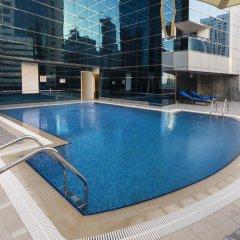 Отель Golden Tulip Al Thanyah бассейн