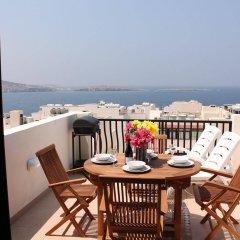 Отель Seashells Apartments Мальта, Буджибба - отзывы, цены и фото номеров - забронировать отель Seashells Apartments онлайн балкон