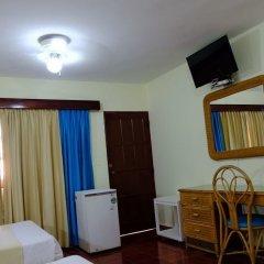 Отель Calypso Beach Доминикана, Бока Чика - отзывы, цены и фото номеров - забронировать отель Calypso Beach онлайн удобства в номере