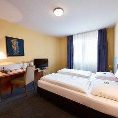 GHOTEL hotel & living München-City комната для гостей