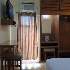 Отель La Gloria Residence Inn сейф в номере