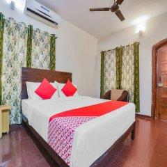 Отель OYO 35492 Solitude Resort Гоа сейф в номере