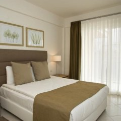 Апартаменты Kusadasi Golf and Spa Apartments Сельчук комната для гостей фото 2