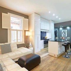 Апартаменты Beautiful Kensington 2 Bedroom Luxury Apartment Лондон комната для гостей фото 5