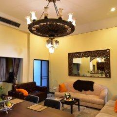 Отель Mangosteen Bangkok Sukhumvit Бангкок интерьер отеля