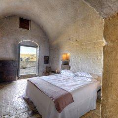 Отель Sextantio Le Grotte Della Civita Матера комната для гостей фото 4