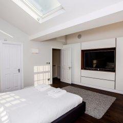 Отель Luxurious 4 Bedroom Flat by Baker Street Великобритания, Лондон - отзывы, цены и фото номеров - забронировать отель Luxurious 4 Bedroom Flat by Baker Street онлайн комната для гостей