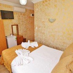 Апартаменты Camelot Apartment комната для гостей