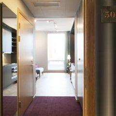 Апартаменты Apartments by Ligula Hammarby Sjöstad Стокгольм сейф в номере
