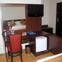 Отель Grand Inn & Suites удобства в номере фото 2
