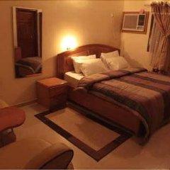 Отель Scholet Suites Нигерия, Калабар - отзывы, цены и фото номеров - забронировать отель Scholet Suites онлайн комната для гостей