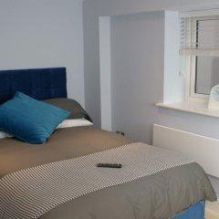 Апартаменты St Anns Square Apartments комната для гостей фото 5