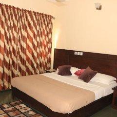Liz Ani Hotel Annex Калабар сейф в номере