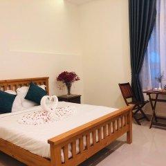 Отель Sum Villa Hoi An комната для гостей