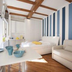 Отель At Home Heart of Milan - Manzoni Италия, Милан - отзывы, цены и фото номеров - забронировать отель At Home Heart of Milan - Manzoni онлайн комната для гостей