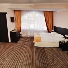 Гостиница Оптима Черкассы комната для гостей фото 4