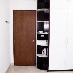 Апартаменты Maxshare Hotels & Serviced Apartments сейф в номере