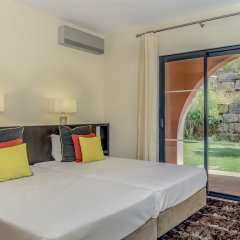 Апартаменты Amendoeira Golf Resort - Apartments and villas комната для гостей фото 12