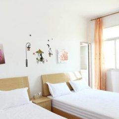Апартаменты Happiness Apartment Сямынь комната для гостей фото 5