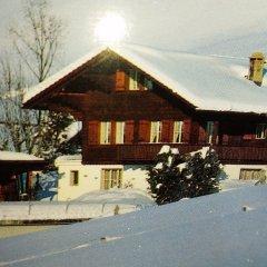Отель Gstaad - Amazing Lake Chalet парковка