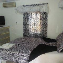 Отель Sweets Guest House Ямайка, Монтего-Бей - отзывы, цены и фото номеров - забронировать отель Sweets Guest House онлайн комната для гостей