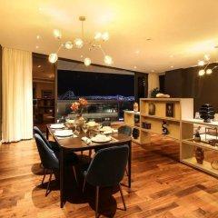 Отель Explore City Walk From an Exquisite Sanctuary ОАЭ, Дубай - отзывы, цены и фото номеров - забронировать отель Explore City Walk From an Exquisite Sanctuary онлайн питание